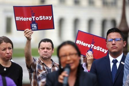 Immigrant rights organizations rally to to call on Congress to create a path to permanent status for TPS holders and DACA recipients at the U.S. Capitol in Washington