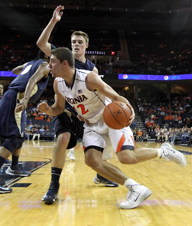 Virginia guard Joe Harris (12) drives past Navy guard Kendall Knorr (1) during the first half of an NCAA basketball game Tuesday Nov. 19, 2013 in Charlottesville, Va. (AP Photo/Andrew Shurtleff)