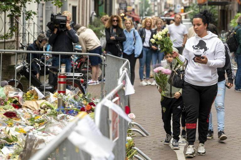 People bring flowers for the late Peter R. de Vries in the center of Amsterdam