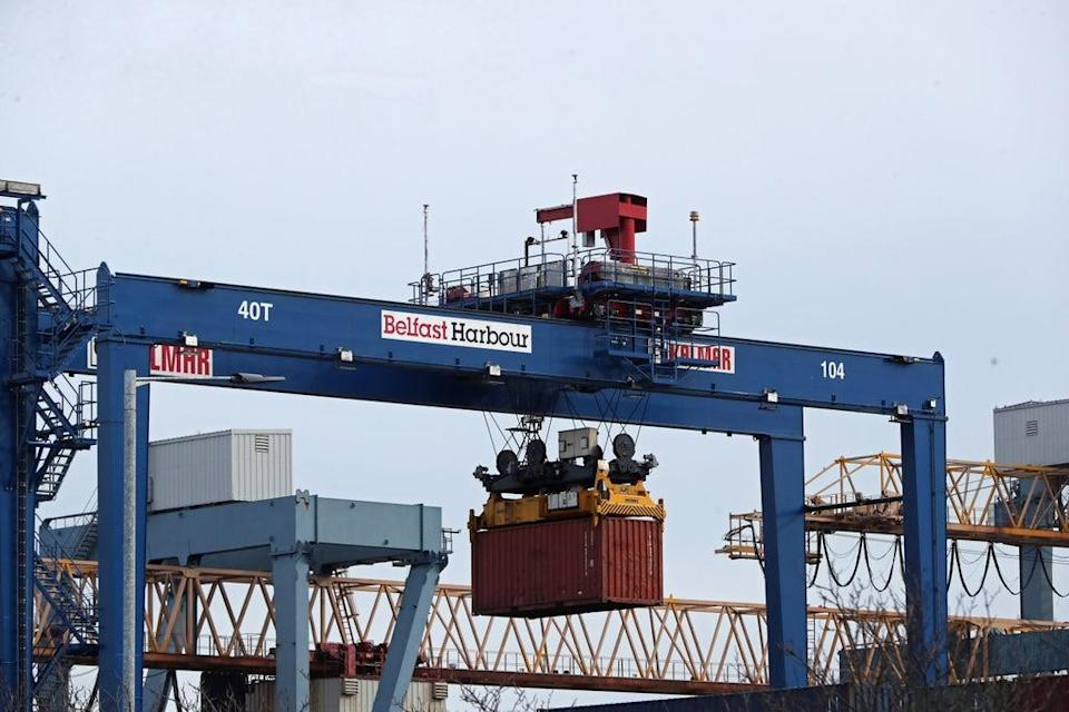 A cargo crate being moved at Belfast Port (PA) (PA Archive)