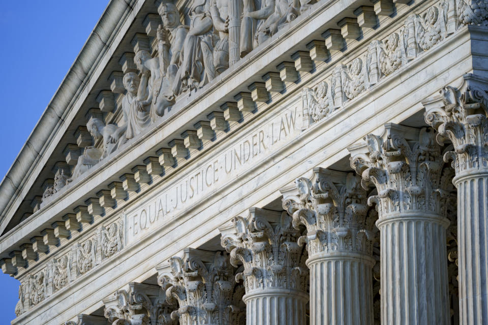 FILE - In this June 30, 2021, file photo the Supreme Court is seen in Washington. As congressional Democrats gear up for another bruising legislative push to expand voting rights, much of their attention has quietly focused on a small yet crucial voting bloc with the power to scuttle their plans: the nine Supreme Court justices. (AP Photo/J. Scott Applewhite, File)