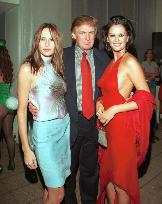 <p>Donald Trump with girlfriend Melania Knauss, left, and Kylie Bax attend a party at the Playboy Penthouse in New York City on Sept. 6, 2000. (Photo: Steve Azzara/Corbis via Getty Images) </p>
