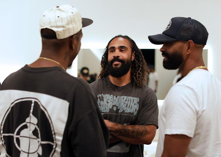 "Designer Jerry Lorenzo, center, opened a temporary Fear of God store in downtown L.A.'s Arts District last year. <span class=""copyright"">(Myung J. Chun / Los Angeles Times)</span>"