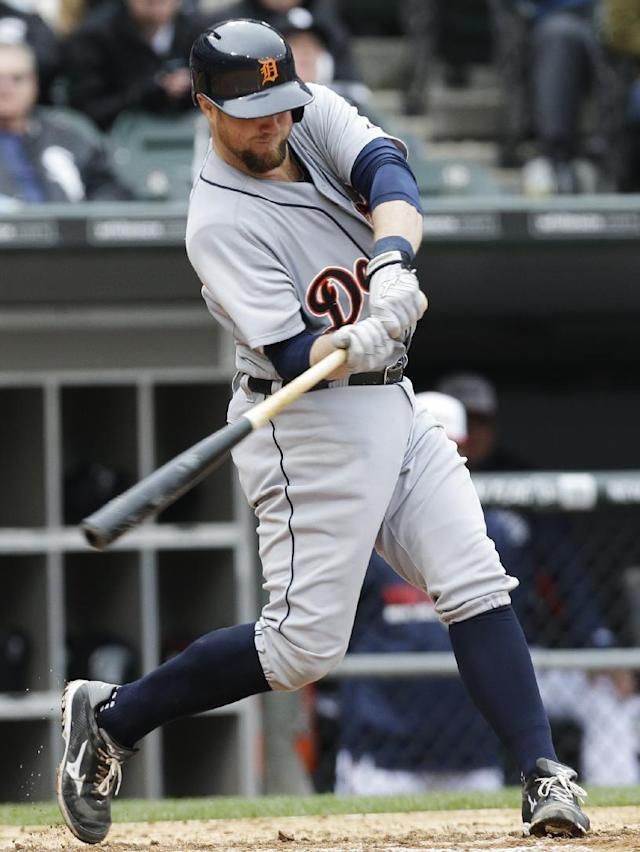 Detroit Tigers' Bryan Holaday hits a two-run double against the Chicago White Sox during the fourth inning of a baseball game in Chicago on Wednesday, April 30, 2014. (AP Photo/Nam Y. Huh)