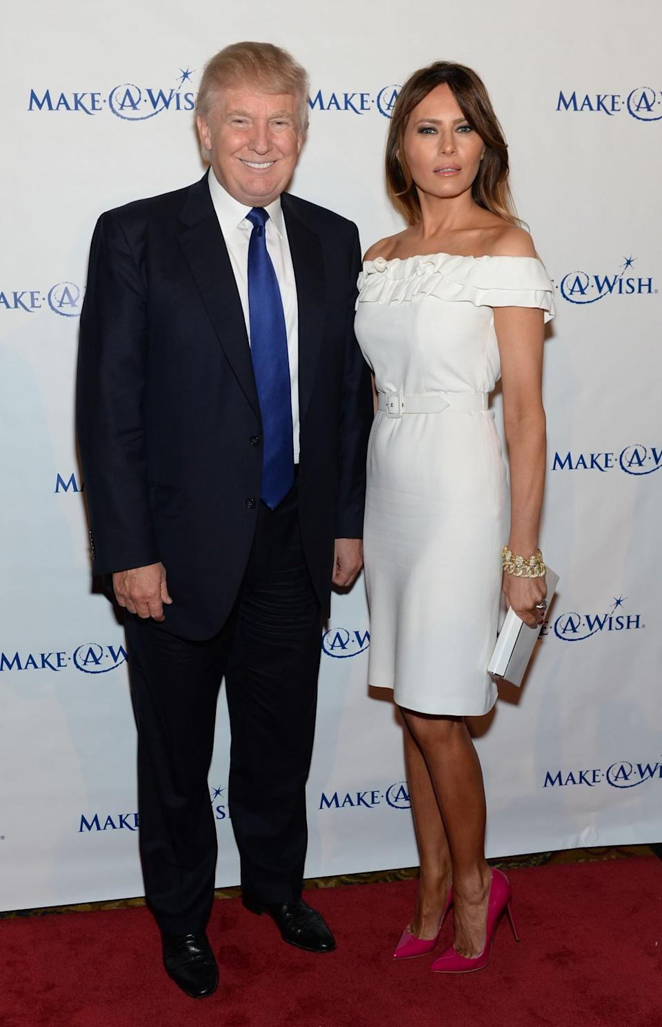 <p>Going back to white, Melania worked a belted dress and patent pink stilettos to attend a charity gala with her husband, Donald Trump. <i>[Photo: Getty]</i> </p>