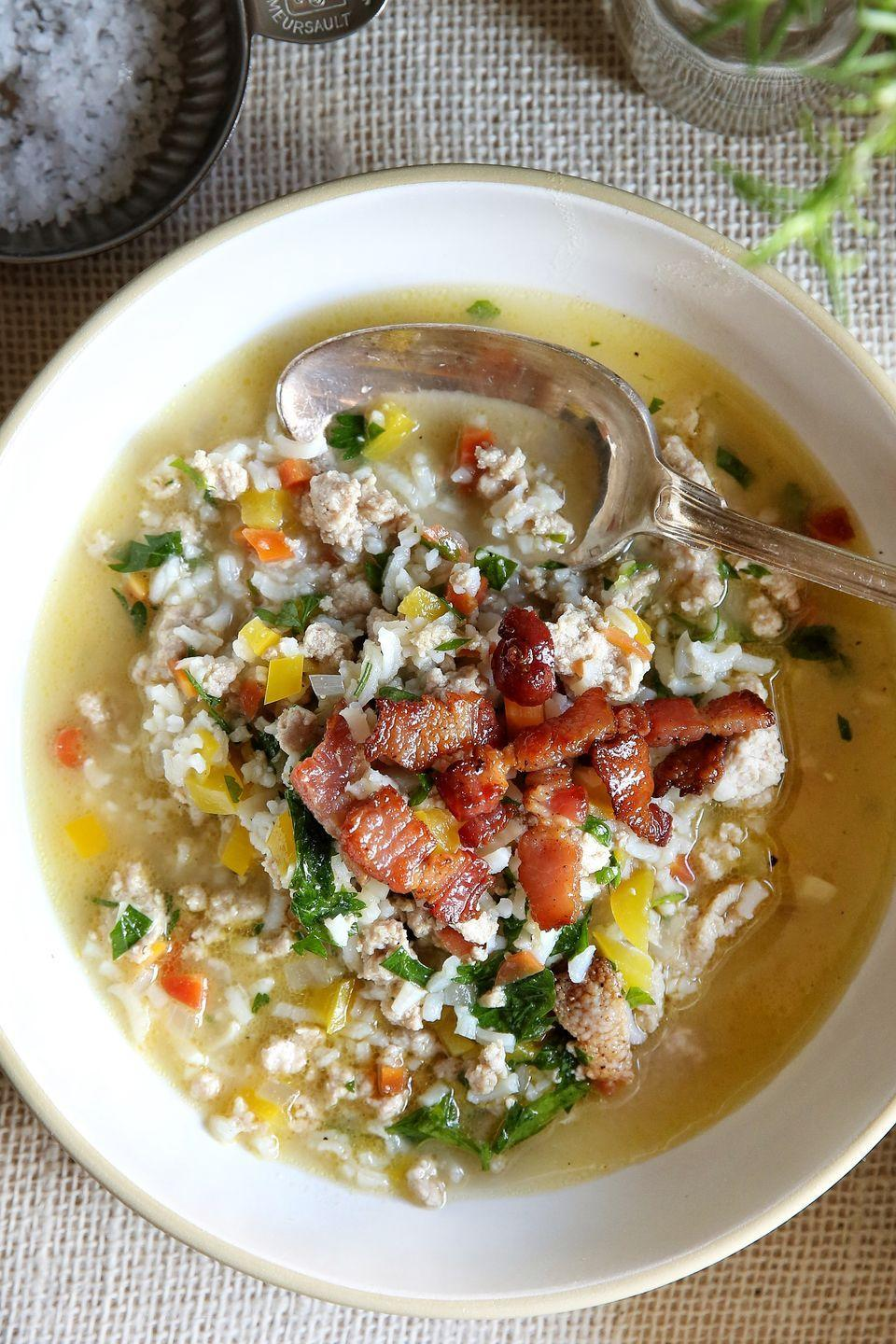 """<p>Whip up a big pot to eat all week following the big feast.</p><p>Get the recipe from <a href=""""https://www.delish.com/cooking/recipe-ideas/recipes/a50147/leftover-turkey-rice-soup-recipe/"""" rel=""""nofollow noopener"""" target=""""_blank"""" data-ylk=""""slk:Delish"""" class=""""link rapid-noclick-resp"""">Delish</a>.</p>"""