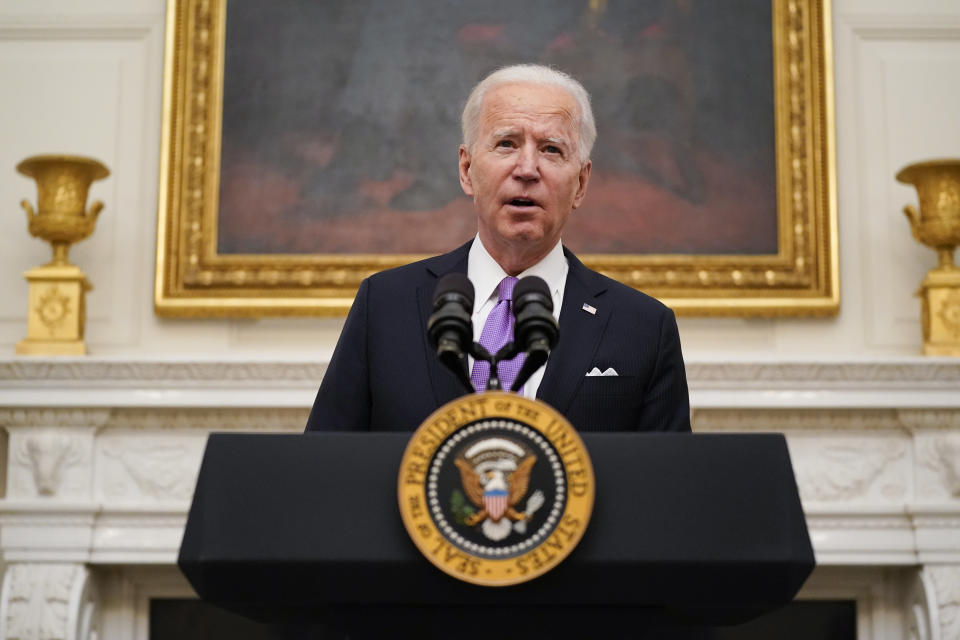 President Joe Biden speaks about the coronavirus in the State Dinning Room of the White House, Thursday, Jan. 21, 2021, in Washington. (AP Photo/Alex Brandon)