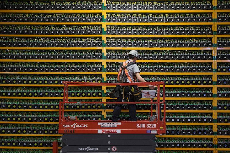 Japanese financial institution will soon begin mining cryptocurrencies including bitcoin. | Source: Photo by Lars Hagberg / AFP