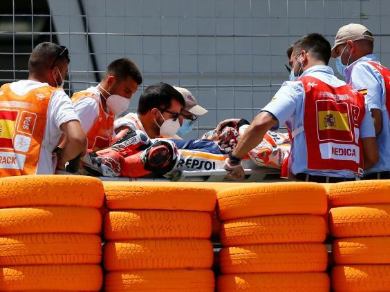 Marquez was carried away on a stretcher after the high-speed accident (Reuters)