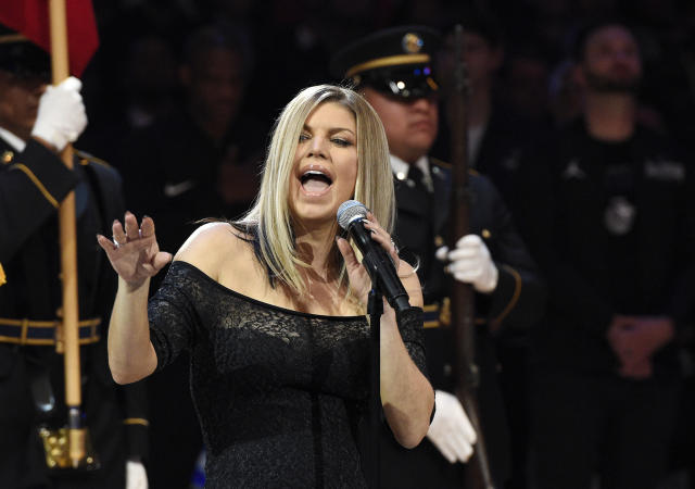 Singer Fergie performs the national anthem prior to an NBA All-Star basketball game, Sunday, Feb. 18, 2018, in Los Angeles. (AP Photo/Chris Pizzello)