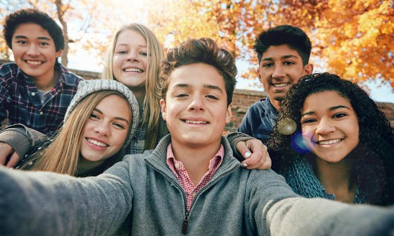 'Childhood and youth have lost their vital exclusivity: young friends pose for a selfie.