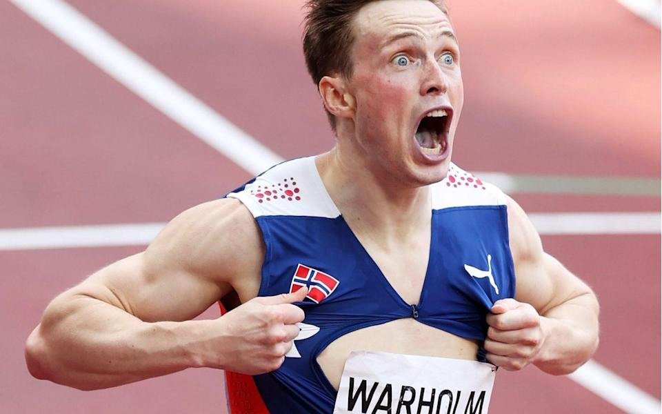 Karsten Warholm of Team Norway reacts after winning the gold medal in the Men's 400m Hurdles Final on day eleven of the Tokyo 2020 Olympic Games at Olympic Stadium on August 03, 2021 in Tokyo - GETTY IMAGES