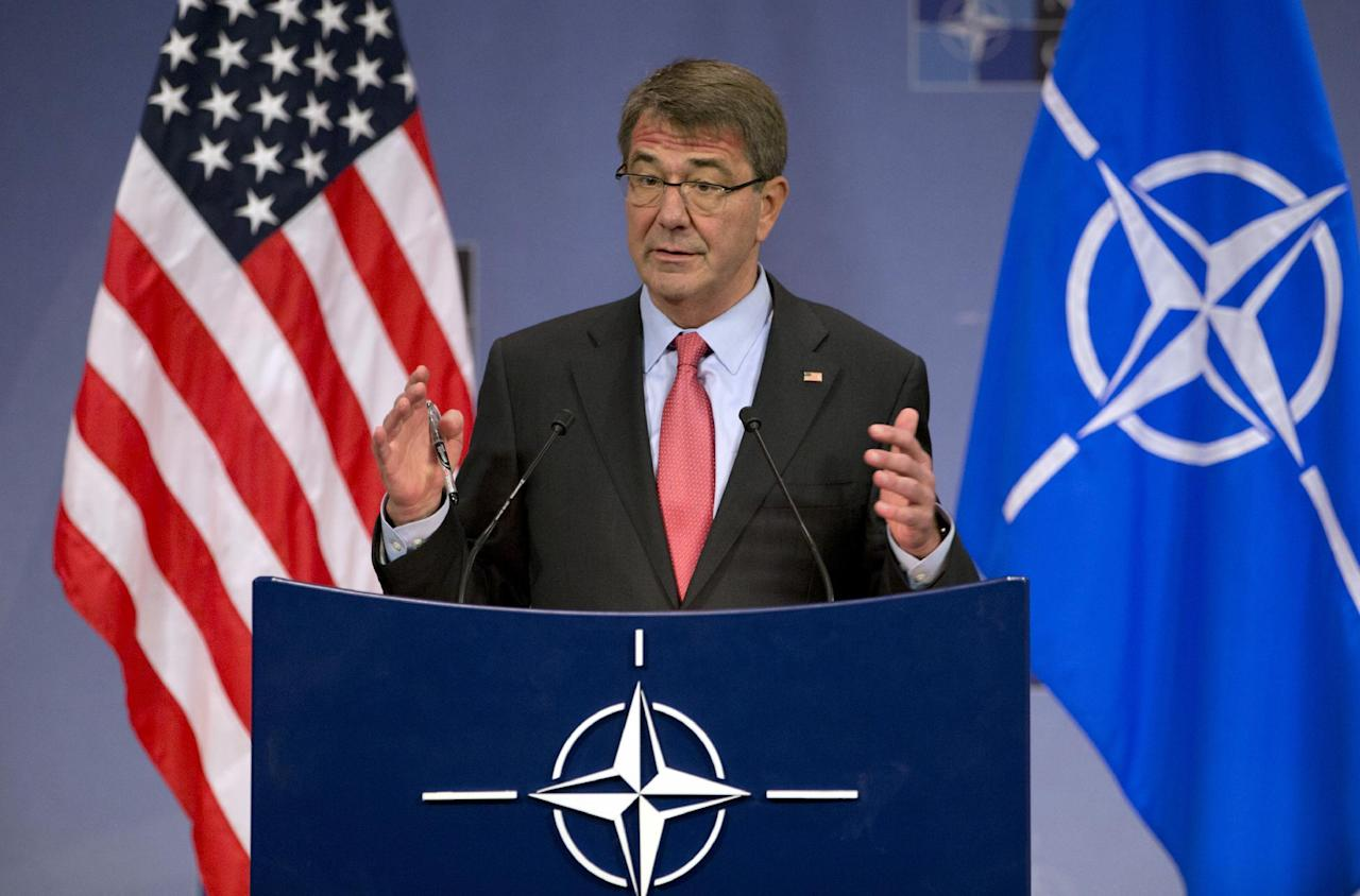 U.S. Secretary of Defense Ash Carter speaks during a media conference at NATO headquarters in Brussels on Thursday, Feb. 11, 2016. NATO defense ministers met for a second day on Thursday to discuss Turkey's request to help deal with Europe's ongoing migrant crisis and the current situation in Iraq and Syria. (AP Photo/Virginia Mayo)