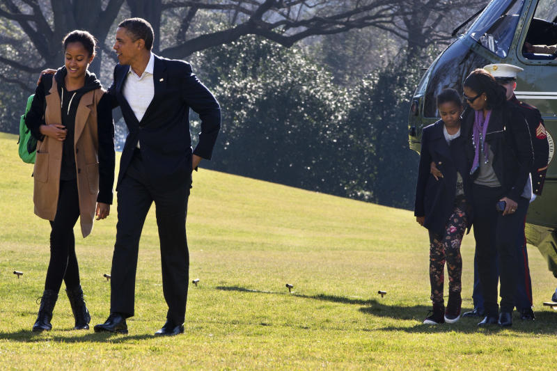 Obama returns to capital after Hawaii vacation