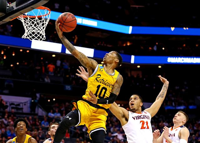 Mar 16, 2018; Charlotte, NC, USA; UMBC Retrievers guard Jairus Lyles (10) shoots the ball against Virginia Cavaliers forward Isaiah Wilkins (21) during the second half in the first round of the 2018 NCAA Tournament at Spectrum Center. Mandatory Credit: Jeremy Brevard-USA TODAY Sports TPX IMAGES OF THE DAY