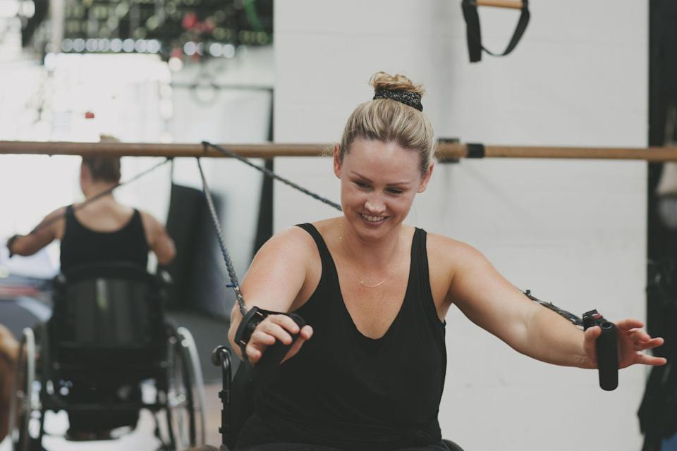 """<p class=""""body-text"""">Exercising in a wheelchair is amongst one of the best and most varied ways to stay fit, build strength and get moving each week. Whether you prefer <a href=""""https://www.womenshealthmag.com/uk/fitness/strength-training/a36107039/resistance-training/"""" rel=""""nofollow noopener"""" target=""""_blank"""" data-ylk=""""slk:resistance training"""" class=""""link rapid-noclick-resp"""">resistance training</a> exercises, <a href=""""https://www.womenshealthmag.com/uk/fitness/running/g27125112/cardio-home-workouts/"""" rel=""""nofollow noopener"""" target=""""_blank"""" data-ylk=""""slk:cardio workout"""" class=""""link rapid-noclick-resp"""">cardio workout</a> blasts or calming <a href=""""https://www.womenshealthmag.com/uk/fitness/yoga/"""" rel=""""nofollow noopener"""" target=""""_blank"""" data-ylk=""""slk:yoga"""" class=""""link rapid-noclick-resp"""">yoga</a> flows, there's something for every taste. </p><p class=""""body-text"""">We asked personal trainer and director of <a href=""""https://www.instagram.com/adapttoperform/"""" rel=""""nofollow noopener"""" target=""""_blank"""" data-ylk=""""slk:Adapt to Perform"""" class=""""link rapid-noclick-resp"""">Adapt to Perform</a> <a href=""""https://www.youtube.com/channel/UClosZzwrXmjPzDCwD9OcC0A"""" rel=""""nofollow noopener"""" target=""""_blank"""" data-ylk=""""slk:Ben Clark"""" class=""""link rapid-noclick-resp"""">Ben Clark</a> to break down what you need to know about exercising in a wheelchair and how to make it work for you. </p><h2 class=""""body-h2"""">What are the benefits of doing workouts in your wheelchair?</h2><p>'Working out as a wheelchair user brings the same benefits to you as it would as a non-wheelchair user improving areas such as cardiovascular health, strength and <a href=""""https://www.womenshealthmag.com/uk/fitness/strength-training/a708496/mobility/"""" rel=""""nofollow noopener"""" target=""""_blank"""" data-ylk=""""slk:mobility"""" class=""""link rapid-noclick-resp"""">mobility</a> depending on the type of exercises you are doing,' explains Clark. </p><p>'The knock-on effect of these can have huge ramifications on your day to day life. Having better muscul"""