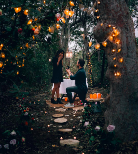 Tyson got down on one knee in a romantic forest setting. Photo: Instagra