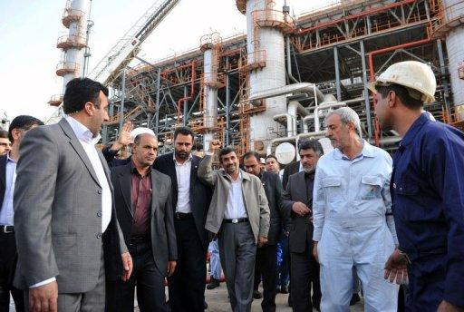 Iranian President Mahmoud Ahmadinejad (C) tours the Abadan oil refinery during the inauguration of a petrol making unit in the southwestern city of Abadan in 2011. A European Union embargo on Iranian oil went into effect on Sunday, provoking anger in Tehran which says the measure will hurt talks with world powers over its sensitive nuclear activities