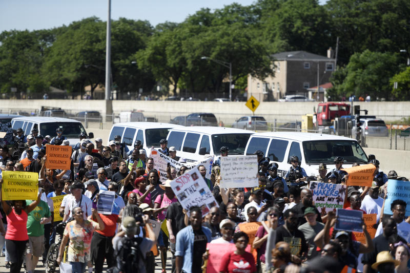 Protesters march on the Dan Ryan Expressway, Saturday, July 7, 2018, in Chicago. The protesters shut down the expressway to draw attention to the city's gun violence and pressure public officials to do more to help neighborhoods hardest hit by it.(AP Photo/Annie Rice)