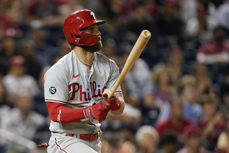 Philadelphia Phillies' Bryce Harper doubles in the eighth inning of a baseball game against the Washington Nationals, Wednesday, Aug. 4, 2021, in Washington. Travis Jankowski scored on the play. (AP Photo/Patrick Semansky)