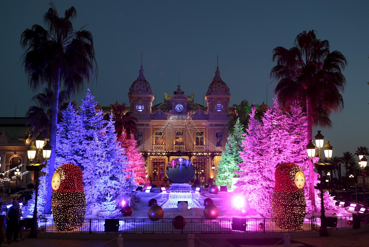 """Christmas trees frame the Monte Carlo Casino as part of holiday season decorations in Monaco, December 10, 2015. The humble Christmas tree has a rich history, from evergreen trees used to symbolise eternal life in Ancient Egypt to tree worship among pagan Europeans. The modern version has its origins in Germany, where the song """"O Tannenbaum"""" is still a festive favourite. Today the traditional tree with lights and decorations appears in cities including Washington, Moscow and Beirut. Alternative constructions range from recycled rubbish in Mexico City to old window frames in Rakvere, Estonia. Whatever the shape or size, the message is the same: Merry Christmas.REUTERS/Eric Gaillard PICTURE 2 OF 28 - SEARCH """"GLOBAL TREES"""" FOR ALL IMAGES"""