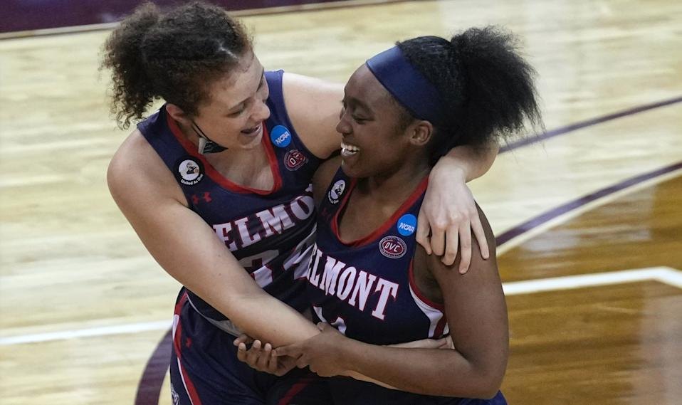 Destinee Wells, right, celebrates with Cam Browning, left, after Belmont's win over Gonzaga in a college basketball game in the first round of the women's NCAA tournament at the University Events Center in San Marcos, Texas, Monday, March 22, 2021. (AP Photo/Chuck Burton)