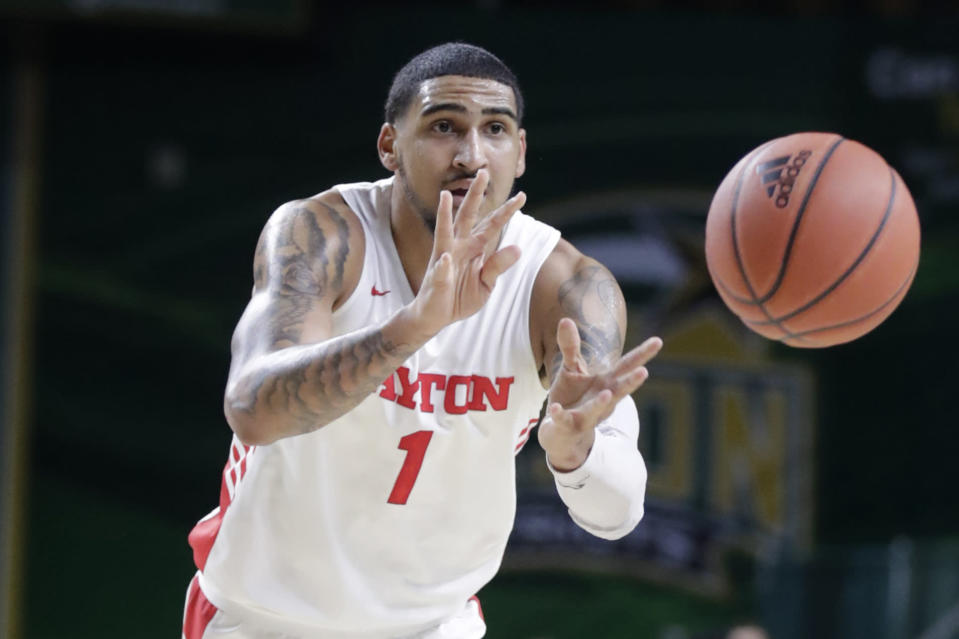 Dayton's Obi Toppin (1) passes the ball during the first half of an NCAA college basketball game against George Mason, Tuesday, Feb. 25, 2020, in Fairfax, Va. (AP Photo/Luis M. Alvarez)