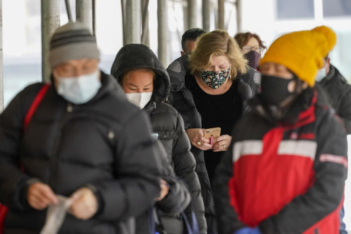 People line up for a COVID-19 vaccine outside a NYC Health Department clinic on Feb. 9, 2021, in New York. (Mary Altaffer/AP)