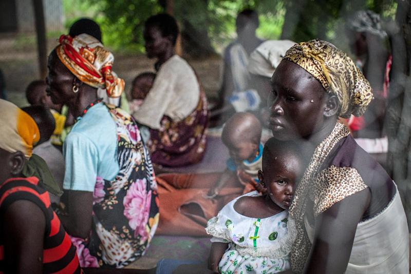 Families with malnourished children wait to receive treatment at the Leer Hospital, South Sudan, on July 7, 2014 (AFP Photo/Nichole Sobecki)