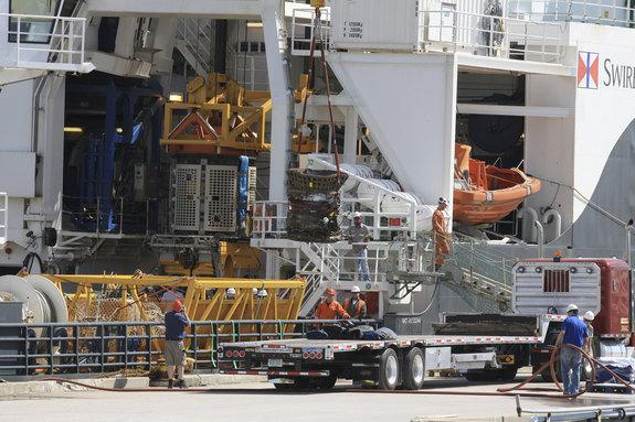 Workers unload parts for two Apollo Saturn V F-1 rocket engines recovered from the ocean floor by a private expedition led by Jeff Bezos, founder and CEO of Amazon.com and the commercial spaceflight company Blue Origin.