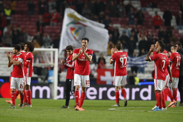 Benfica players celebrate at the end of the Champions League group G soccer match between Benfica and Zenit St. Petersburg at the Luz stadium in Lisbon, Tuesday, Dec. 10, 2019. Benfica won 3-0. (AP Photo/Armando Franca)