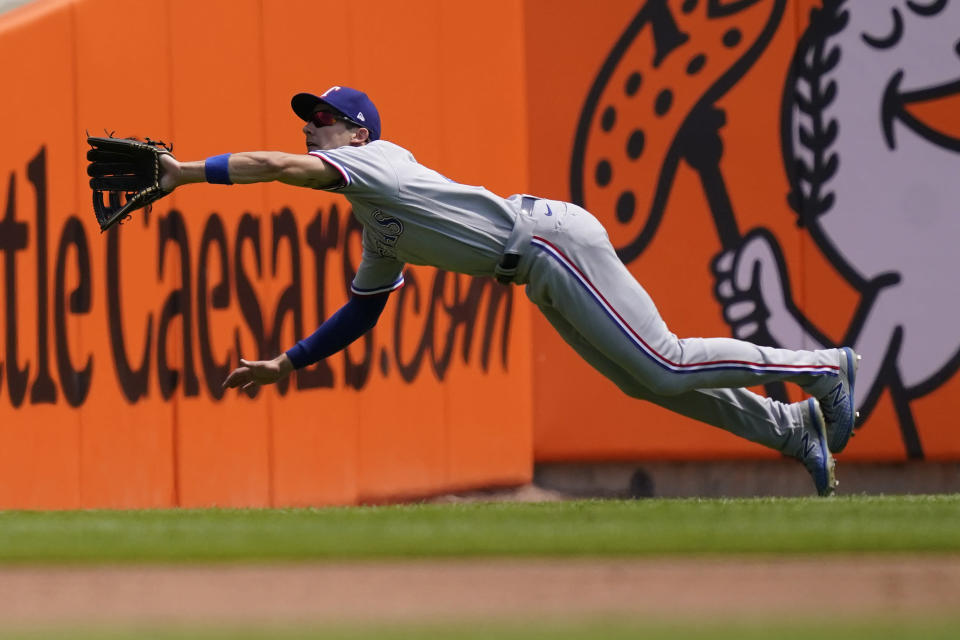 Texas Rangers left fielder Eli White dives and catches the fly out hit by Detroit Tigers' Akil Baddoo during the second inning of a baseball game, Thursday, July 22, 2021, in Detroit. (AP Photo/Carlos Osorio)