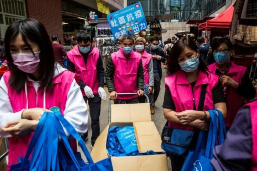 Supporters of a pro-beijing alliance responded by securing their own haul of masks to hand out to the public