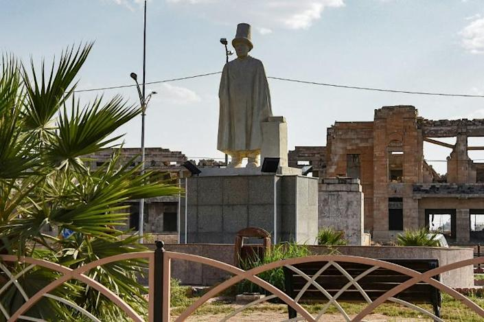 A statue of Mulla Uthman, a Sufi poet from Mosul. The artworks are helping residents shake off memories of brutal punishments meted out by IS in squares and roundabouts, even as much of their city remains in ruins