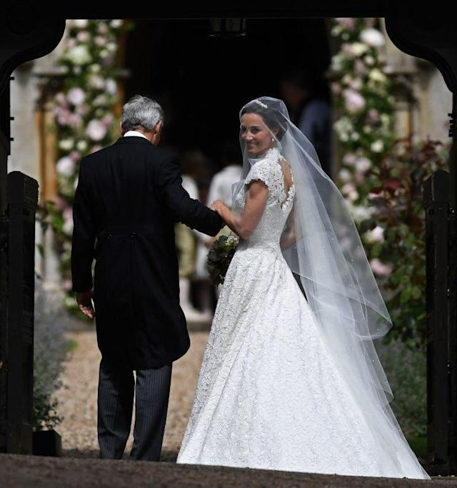 Pippa walks into the church on the arm of her father, Michael Middleton. (Photo: PA)