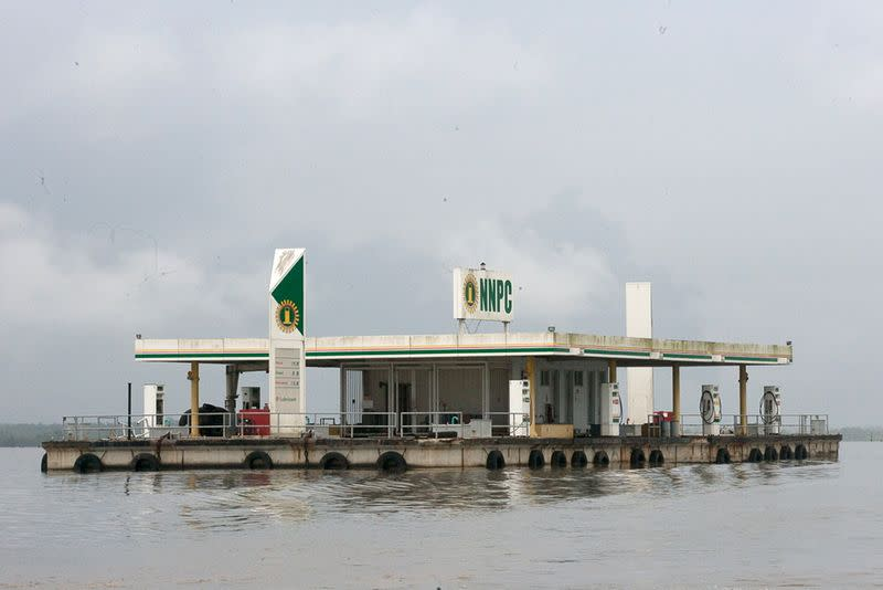 FILE PHOTO: A floating fuel filling station belonging to Nigeria's state oil firm Nigerian National Petroleum Corporation sits idle on a river in the oil rich southeastern Delta state