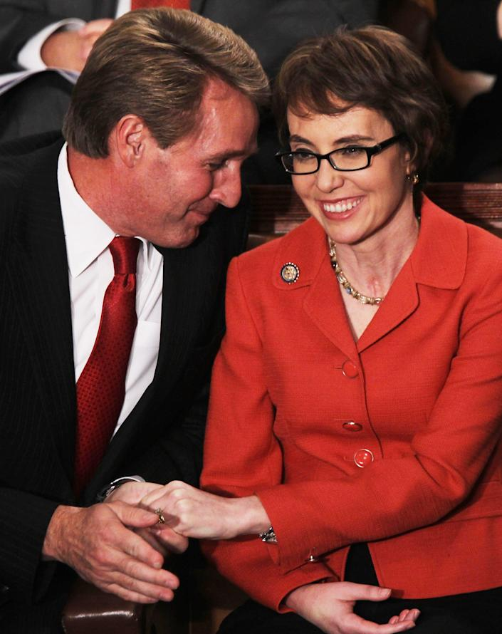 Then-Rep. Jeff Flake talks to Rep. Gabrielle Giffords before the 2012 State of the Union address in Washington, D.C.