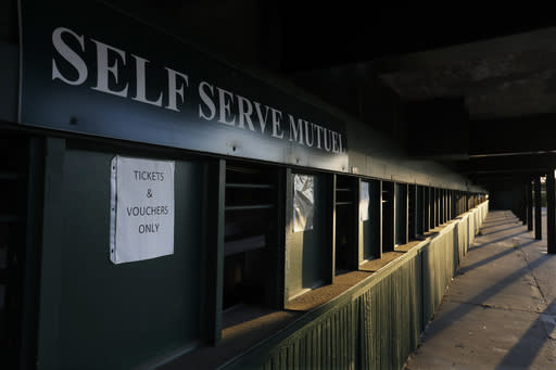 A betting window sits empty at Churchill Downs, Thursday, May 7, 2020, in Louisville, Ky. (AP Photo/Darron Cummings)