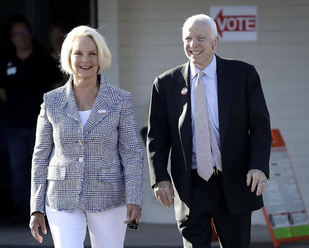 U.S. Sen. John McCain, R-Ariz., and his wife, Cindy McCain, leave a polling station after voting, Tuesday, Aug. 30, 2016, in Phoenix. McCain is seeking the Republican nomination in Arizona's primary election. (AP Photo/Matt York)