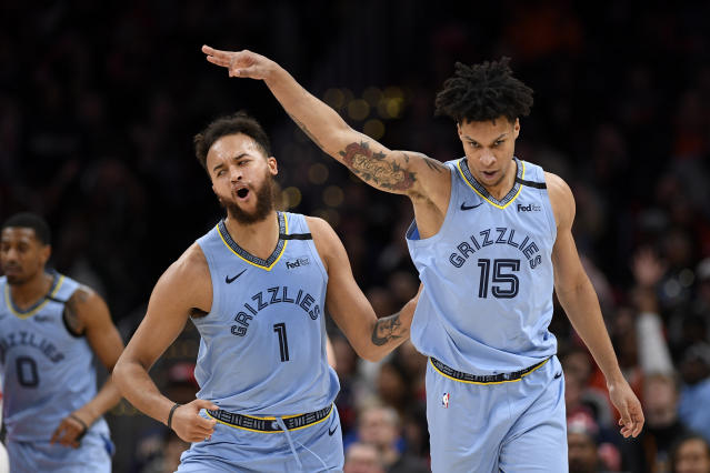 Memphis Grizzlies forward Brandon Clarke (15) reacts after he made a three-point basket with forward Kyle Anderson (1) during the second half of an NBA basketball game Washington Wizards, Sunday, Feb. 9, 2020, in Washington. (AP Photo/Nick Wass)