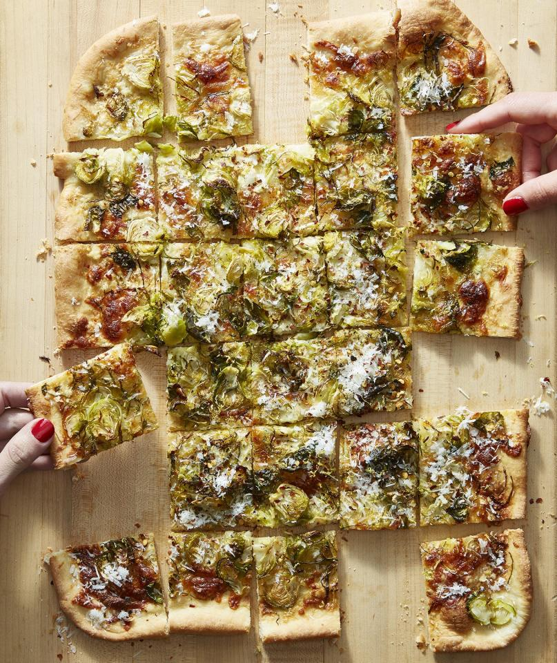 """<p>This seasonal flatbread feeds a crowd, which makes it a delicious, veggie-packed option for a Thanksgiving side or starter. It comes together quickly, but if you'd like to speed up the prep work even more, you can shave Brussels sprouts in your food processor or buy pre-packed shredded sprouts. </p> <p><strong>Get the recipe: </strong><a href=""""https://www.realsimple.com/food-recipes/browse-all-recipes/brussels-sprouts-flatbread"""" target=""""_blank"""">Brussels Sprout Pizza With Lemon and Pecorino</a></p>"""