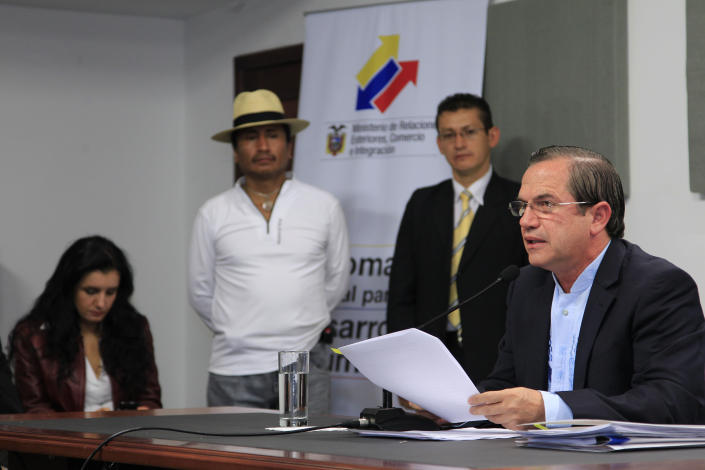 Ecuador's Foreign Minister Ricardo Patino, right, gives a news conference where he announced that Ecuador would grant asylum to WikiLeaks' founder Julian Assange, in Quito, Ecuador, Thursday, Aug. 16, 2012. The announcement comes two months after Assange took refuge in its London embassy to avoid extradition to Sweden to face questioning for alleged sexual misconduct. (AP Photo/Dolores Ochoa)