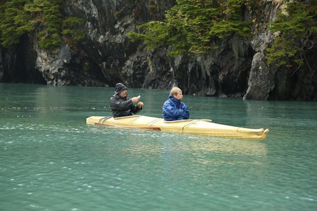 Whittier, Alaska, USA: Marty Raney and Tyler Johnson fishing from the kayak.