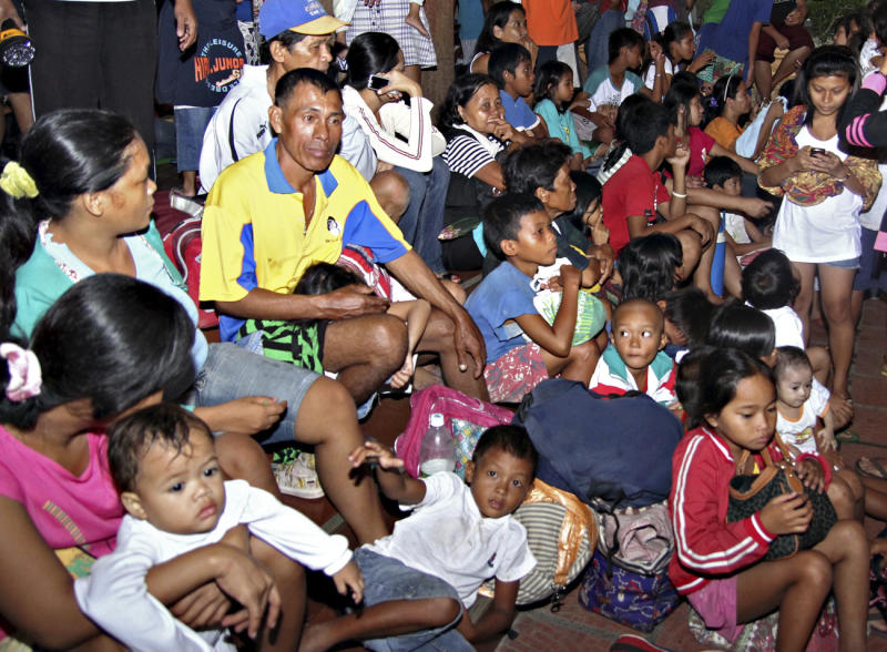 Residents take shelter at the lobby of the city hall in Tandag, Surigao Del Sur province in southern Philippines, following a 7.6 magnitude earthquake that struck eastern and southern Philippines, Friday, Aug. 31, 2012. The quake set off car alarms, shook items off shelves and sent many coastal residents fleeing for high ground before the Pacific Tsunami Warning Center lifted all tsunami alerts it had issued for the Philippines and neighboring countries from Indonesia to Japan, and for Pacific islands as far away as the Northern Marianas. (AP Photo/Erwin Mascarinas)