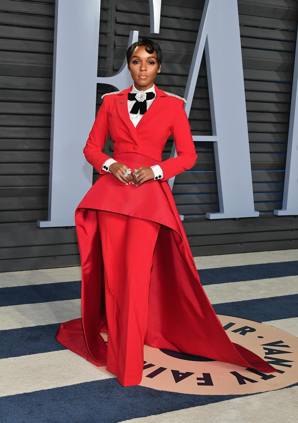 <p>Janelle Monáe is famed for her love of capes on the red carpet and for the <em>Vanity Fair</em> Oscar after-party, the actress wore a slick red co-ord by Christian Siriano. The bejewelled bow, sweeping cape and slick shirt all caught our attention and for that, it's one of the most memorable ensembles of 2018. <em>[Photo: Getty]</em> </p>