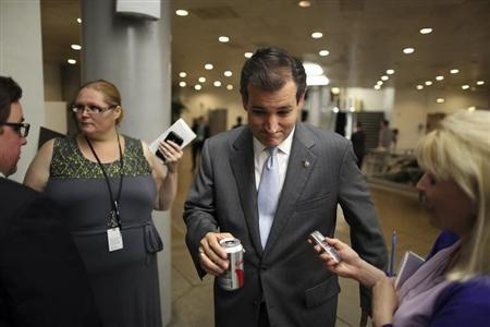 Cruz talks with a reporter after the weekly Republican caucus luncheon at the U.S. Capitol in Washington