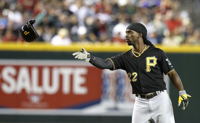 Pittsburgh Pirates' Andrew McCutchen tosses his helmet to a coach as he is stranded on the bases during the third inning of a baseball game against the Arizona Diamondbacks on Sunday, Aug. 3, 2014, in Phoenix. (AP Photo/Ross D. Franklin)