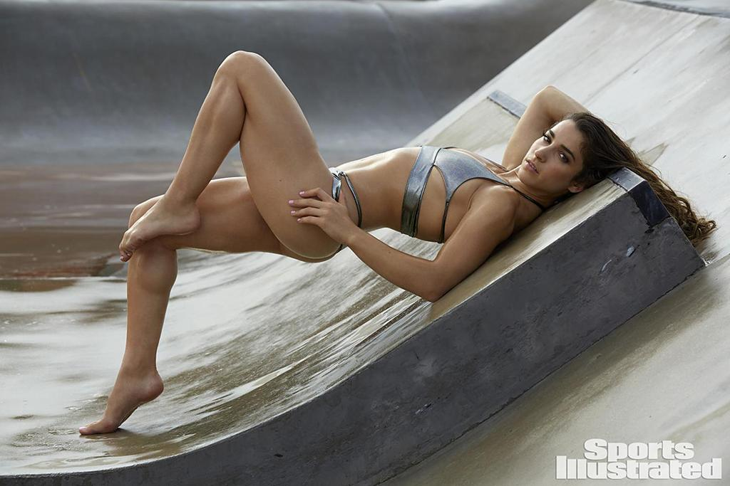 "<p>Raisman <a rel=""nofollow"" href=""http://people.com/sports/aly-raisman-talks-topless-si-swim-photoshoot-feel-confident/"">blushed when shown some of her </a><a rel=""nofollow"" href=""http://www.si.com/swimsuit/"">sexy <i>SI</i> photos</a>, and we're guessing that this was one of the shots that gave her pause. Quite a difference from the bun and sparkly leotard we saw at the Olympics, no? (Photo: James Macari/SPORTS ILLUSTRATED) </p>"