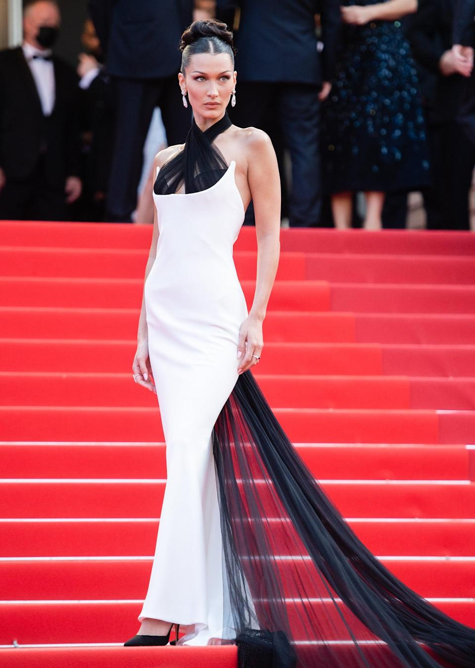 """<p>Weraring <a href=""""https://www.popsugar.com/fashion/bella-hadid-black-white-dress-cannes-2021-48406631"""" class=""""link rapid-noclick-resp"""" rel=""""nofollow noopener"""" target=""""_blank"""" data-ylk=""""slk:a Jean Paul Gaultier piece"""">a Jean Paul Gaultier piece</a> pulled from the archives comes from the label's 2002 Couture collection.</p>"""