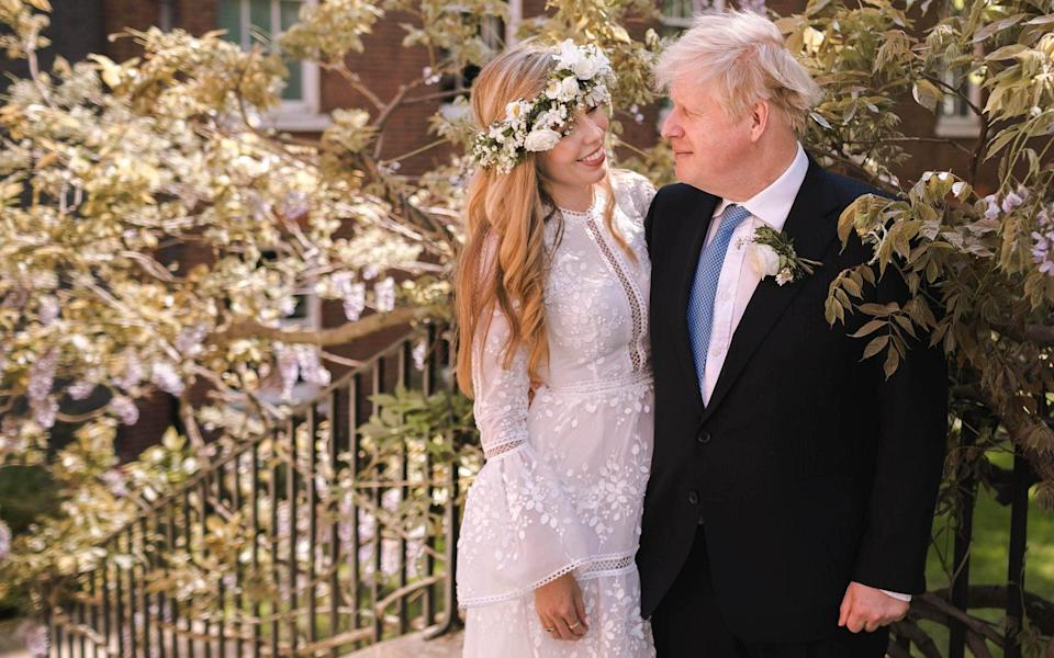 Prime Minister Boris Johnson poses with his wife Carrie Johnson in the garden of 10 Downing Street following their wedding at Westminster Cathedral - Downing Street via Getty Images/Getty Images Europe